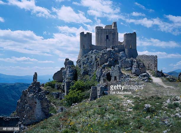 Italy Abruzzo Castel del Monte The ruins of Castel Roche on side of mountain