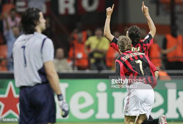 AC Milan's midfielder Kaka of Brazil celebrates with his teammate Andriy Shevchenko as Fenerbahce's goalkeeper Demir Volkan reacts after scoring a...