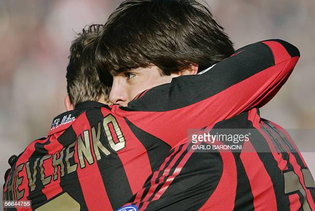 AC Milan's midfielder Kaka of Brazil is congratulated by his teammate forward Andriy Shevchenko of Ukraine after scoring against Siena during the...