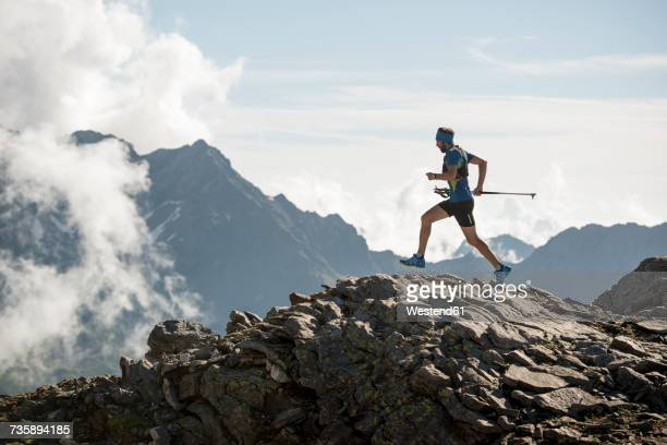 italy, alagna, trail runner on the move near monte rosa mountain massif - cross country running stock pictures, royalty-free photos & images
