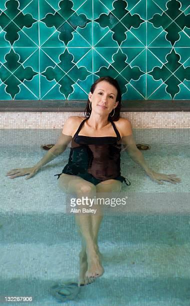 Italy, Amalfi Coast, Ravello, Portrait of mature woman sitting in swimming pool