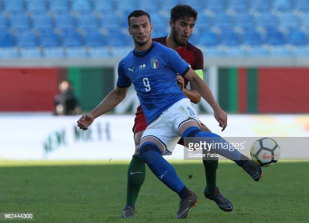 Italy and Spal forward Federico Bonazzoli with Portugal and CD Tondela defender Jorge Fernandes in action during the U21 International Friendly match...