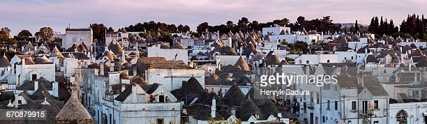 italy, apulia, alberobello, old town panorama of old trulli houses at sunset - alberobello stock photos and pictures