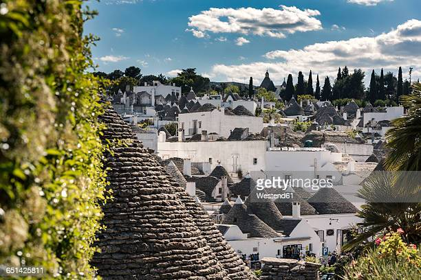 italy, apulia, alberobello, trulli, dry stone huts with conical roofs - alberobello stock pictures, royalty-free photos & images