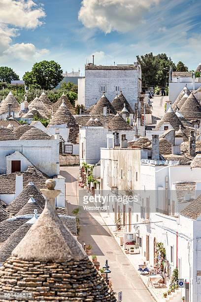 italy, apulia, alberobello, trulli, dry stone huts with conical roofs - alberobello foto e immagini stock