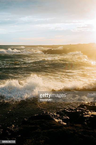 italy, apulia, beautiful sunset on the mediterranean sea - apulien stock-fotos und bilder