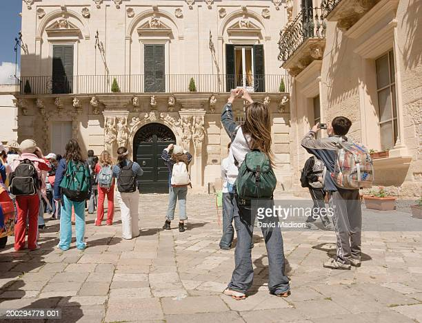 Italy, Apulia, Lecce, children taking pictures of Palazzo Marrese