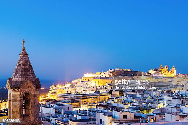 Italy, Apulia, Ostuni, Illuminated townscape at dusk