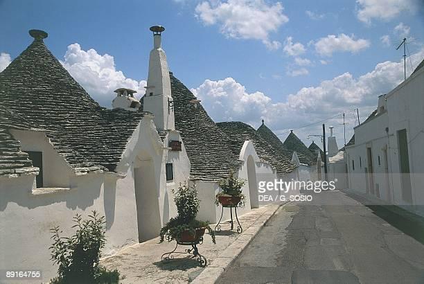 Italy Apulia Region Le Murge Rione Aia Piccola Trulli houses along street