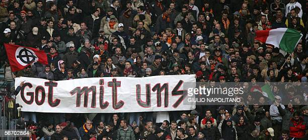 AS Roma's supporters hold a flag bearing a fascist slogan during the Italian serie A football against Livorno at Olympic stadium in Rome 29 January...