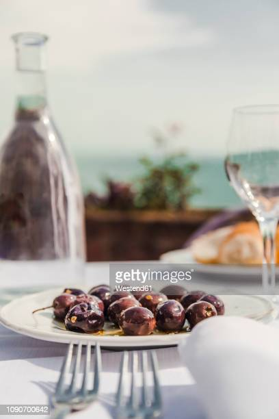 italy, atrani, black olives on plate - antipasto stock pictures, royalty-free photos & images