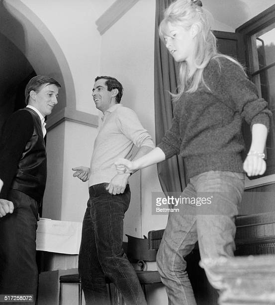 B B Shots It Had To Happen Here's Brigitte Bardot doing the Twist at left is Roger Vadim her former husband who is directing the film in production...