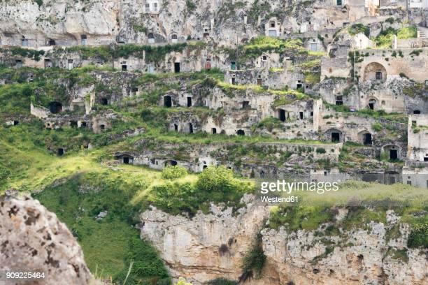 italy, basilicata, matera, gravina di matera and historical cave dwelling, sassi di matera - matera stock photos and pictures