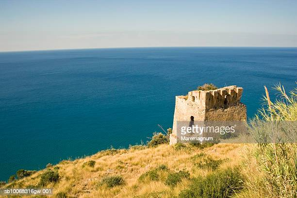 Italy, Calabria, Diamante, ruins on cliff