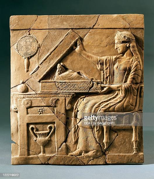 Italy Calabria Locri Pinax depicting a young woman opening a box terracotta