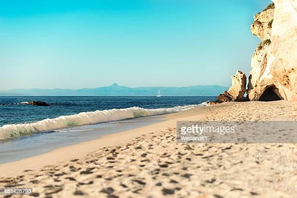 Italy, Calabria, Tropea, cave at beach