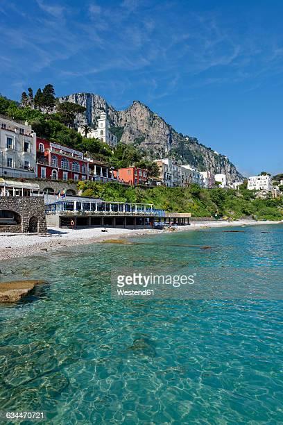 italy, campania, gulf of naples, capri, marina grande, small beach bagni odine - capri stock pictures, royalty-free photos & images