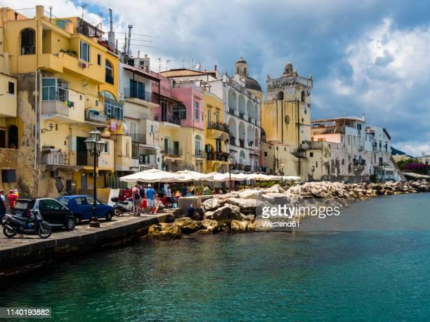 italy, campania, ischia, forio, old town at harbour - uferpromenade stock-fotos und bilder