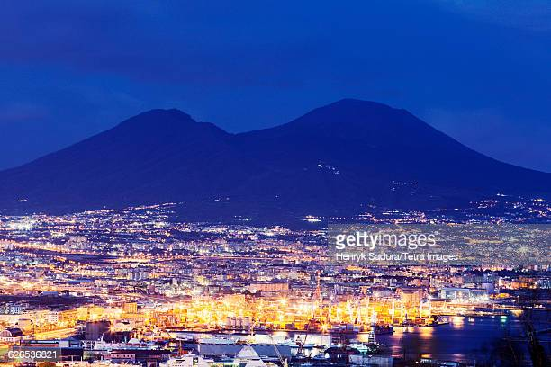 Italy, Campania, Naples, City under Mount Vesuvius at night