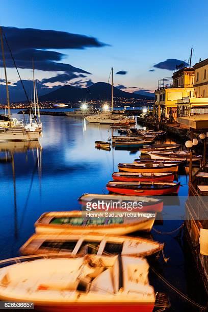 Italy, Campania, Naples, Colorful boats in city marina