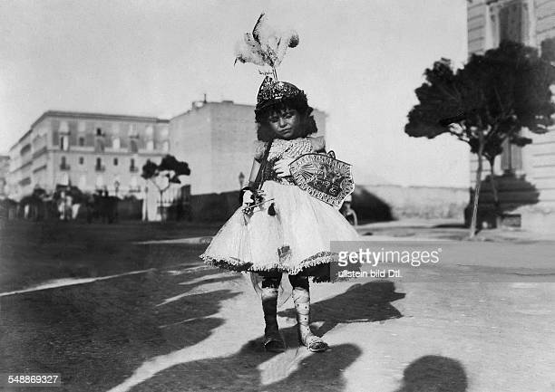 Italy Campania Neapel Napoli Naples Boy dressed up a little Archangel Michael at the St Michael's procession 1902 Photographer Abeniacar Published by...