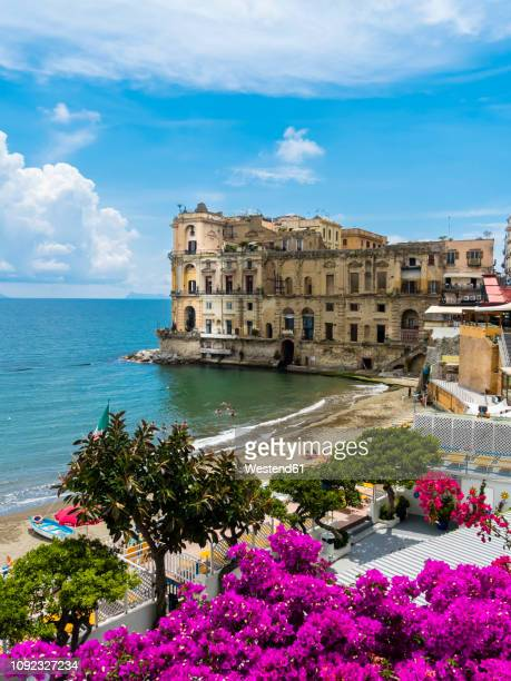 italy, campania, neaples, palazzo donn'anna at gulf of naples - naples italy stock pictures, royalty-free photos & images