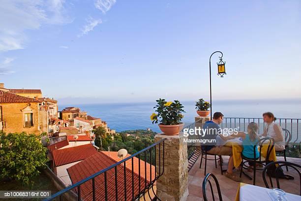 Italy, Campania, Pisciotta, people having breakfast on terrace
