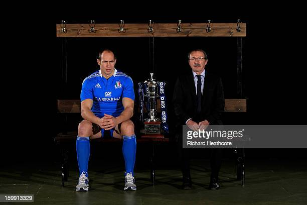 Italy captain Sergio Parisse and Jacques Brunel the Italy head coach pose with the Six Nations trophy during the RBS Six Nations launch at The...