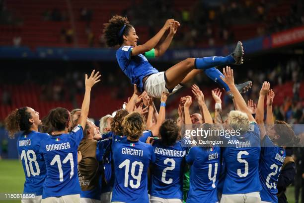 Italy celebrate progressing to the last 16 as players lift Sara Gama of Italy during the 2019 FIFA Women's World Cup France group C match between...