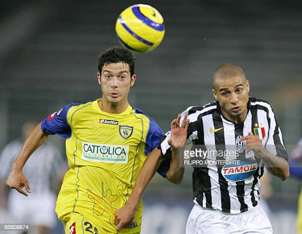 Chievo Verona's Andrea Mantovani fights for the ball with Juventus' David Trezeguet of France during their italian serie A football match at Turin's...