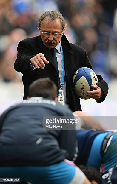 Italy coach Jacques Brunel fine tunes his team prior to the RBS Six Nations match between France and Italy at Stade de France on February 9 2014 in...