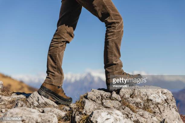 italy, como, detail of hiking boots on the rock - brown boot stock pictures, royalty-free photos & images
