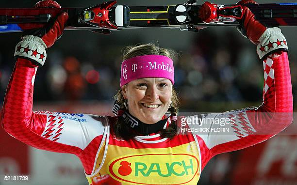 Croatia's Janica Kostelic celebrates in the finish area after the women's slalom at the World Ski Championships in St Caterina 11 February 2005...