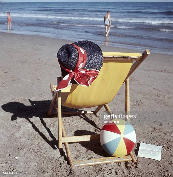 deck chair straw hat and beach ball at a beach at the Adria