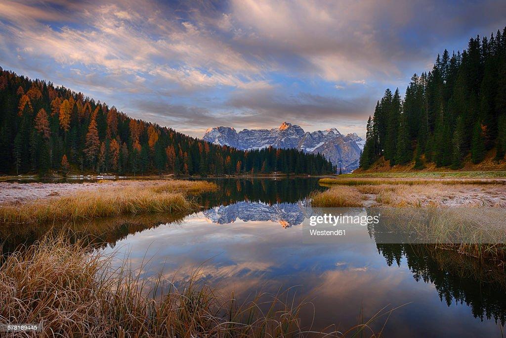 Italy, Dolomites, Belluno, Misurina Lake with mountain Sorapiss at sunrise : ストックフォト