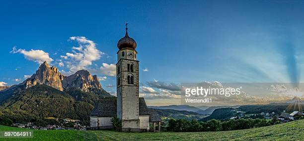 Italy, Dolomites, Church of Saint Valentino and the Sciliar at sunset