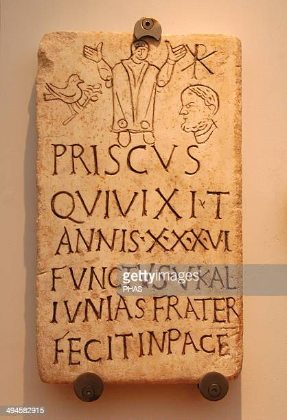 Italy Early Christians Roman funerary stele of Prisco Inscription Christian phrase appears in pace The symbol of the dove and the olive branch and...