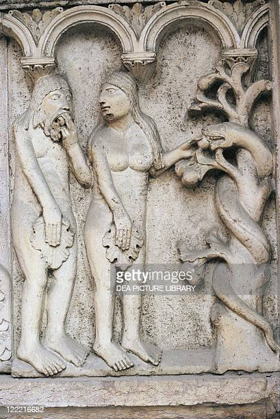 Italy Emilia Romagna Region Modena marble basrelief depicting temptation of Adam and Eve on Cathedral facade