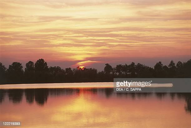 Italy Emilia Romagna Region Regional Park of the Po River Delta Ostellato Valleys Sunset on Delta