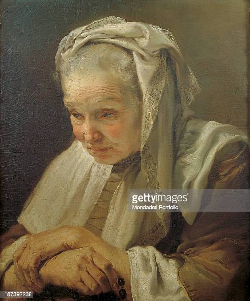 Italy, Emilia-Romagna, Bologna, Cassa di Risparmio di Bologna, All, Head of an old woman with white embroidered veil that seems to weigh on the head...