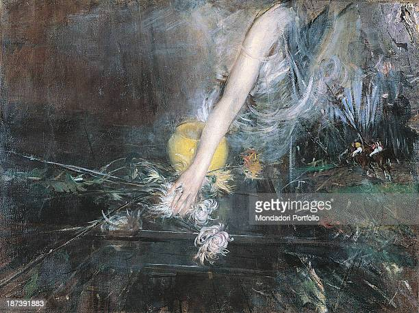 Italy EmiliaRomagna Ferrara Museo Giovanni Boldini Palazzo Massari All An arm puts down some dahlia flowers and a feather boa on a table on which...
