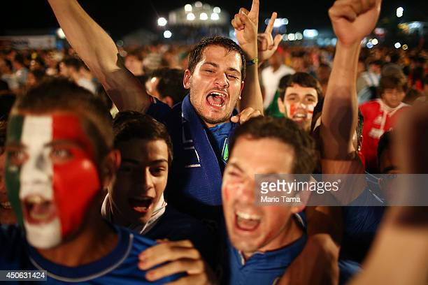 Italy fans celebrate while watching their victory over England at the FIFA Fan Fest on Copacabana Beach on June 14, 2014 in Rio de Janeiro, Brazil....
