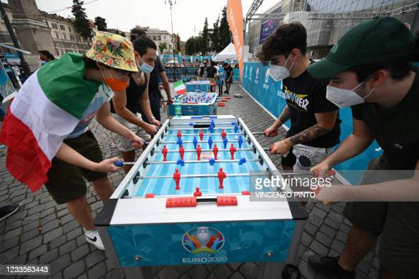 Italy fans play babyfoot at an official fan zone at Piazza del Popolo in Rome, before watching on a giant screen the UEFA EURO 2020 Group A football...