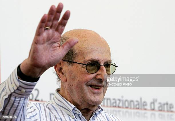 Film director Manoel de Oliveira of Portugal waves to photographers during a photocall of the 62nd edition of Venice International Film Festival at...