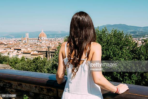 Italy, Florence, woman looking to the city from Piazzale Michelangelo viewpoint