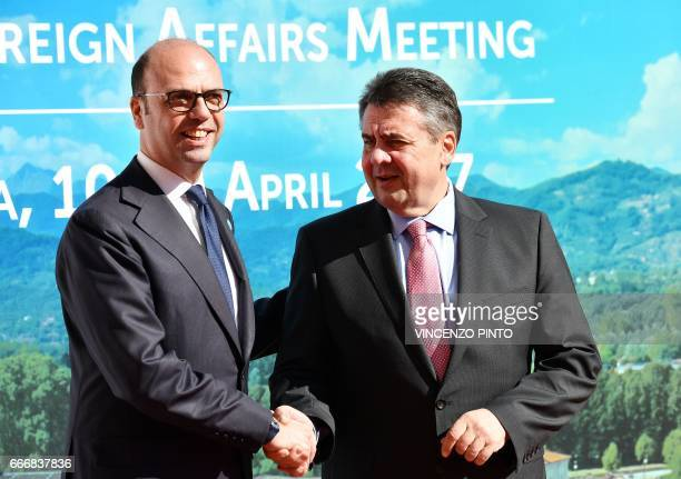 Italy Foreign Minister Angelino Alfano welcomes German Foreign Minister Sigmar Gabriel as he arrives for a meeting of Foreign Affairs Ministers from...