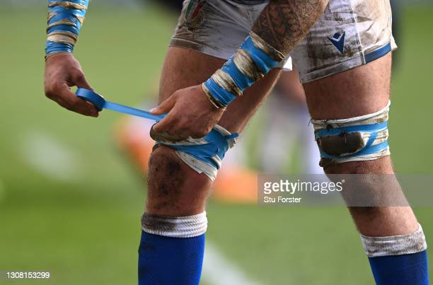 Italy forward Niccolo' Cannone tapes his legs with blue tape during the Guinness Six Nations match between Scotland and Italy at Murrayfield on March...