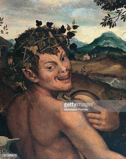 Italy FriuliVenezia Giulia Udine Civici Musei e Gallerie di Storia ed Arte All A horned satyr seen from behind his shoulders smiles at us holding a...
