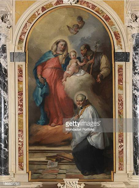 Italy FriuliVenezia Giulia Udine Pocenia parish Church Whole artwork view A divine light illuminating the Holy Family and San Vincenzo kneeling...