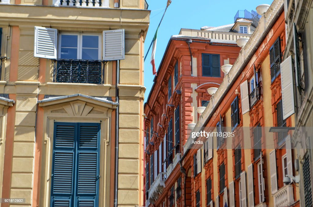 Genoa. Colourful facades of palaces along Via Garibaldi, one of the city's most beautiful streets.